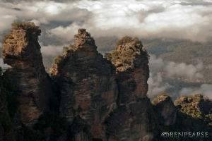 Three sisters with low cloud