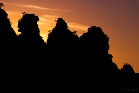 silhouetted sisters on sunrise